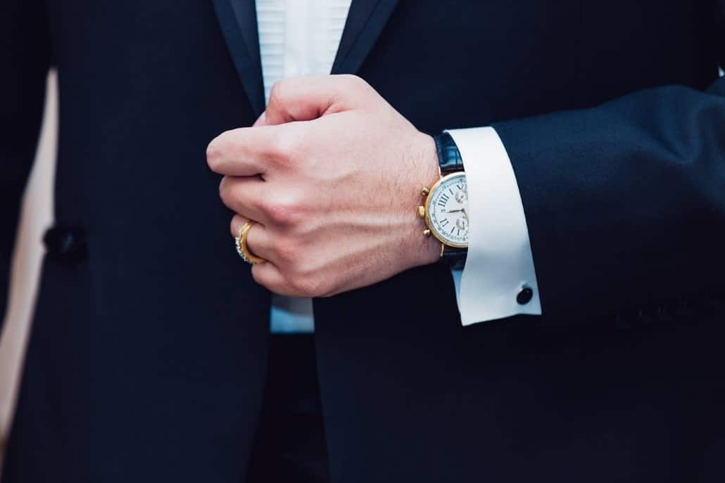 San Jose family law and estate planning attorney in a suit with a nice watch