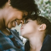 A mother holds her child. Learn about child custody from experienced attorneys