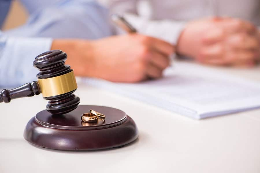 An attorney signs paperwork dividing community property in a divorce