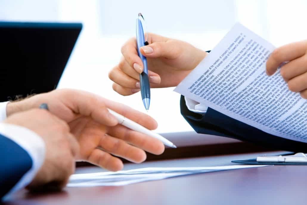 A lawyer and client go over paperwork for setting up a revocable living trust