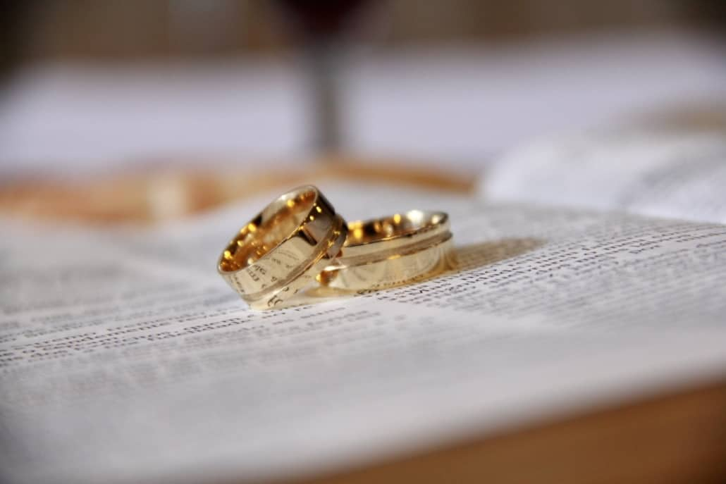 Two wedding rings on top of a child custody agreement