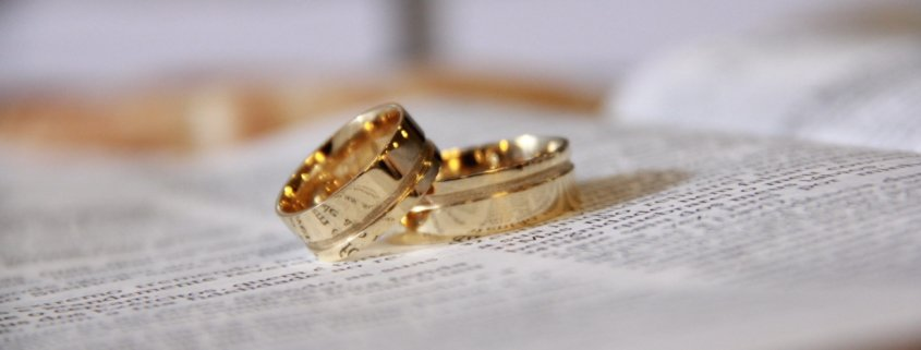 Picture of two rings on top of divorce papers from a high net worth divorce attorney