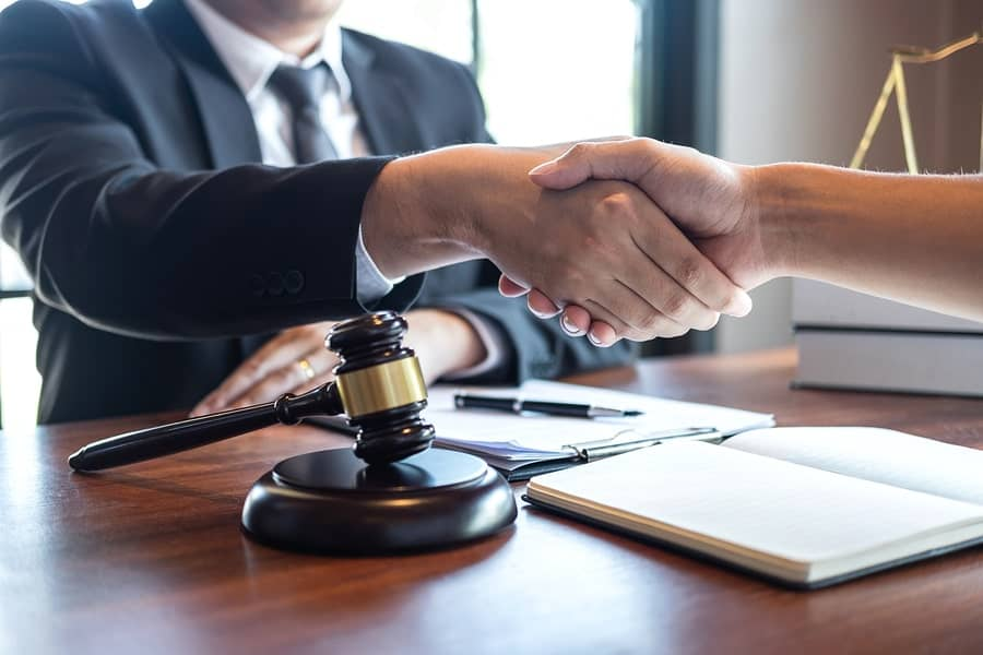 A client in San Jose shakes hands with a certified family law specialist.