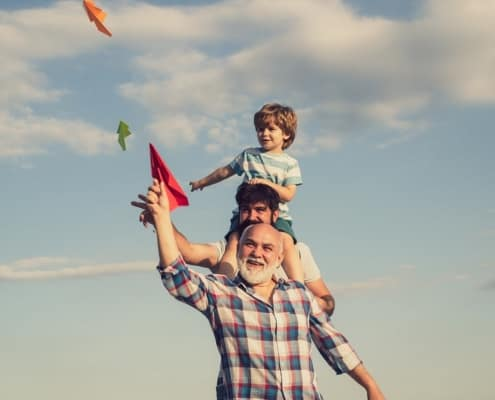 A grandfather spends time outdoors with his grandchild as he prepares to work with lawyers for grandparents rights.