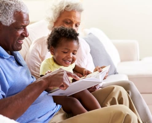 Two grandparents read to their grandchild after winning grandparents rights in a custody case.