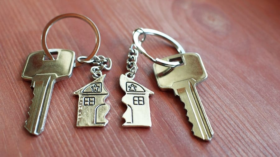 Two keys with a divided household key-chain sit on a table after a couple works with a legal separation attorney.