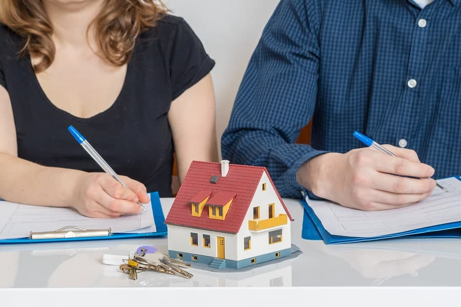 Couple consults with a property division attorney on dividing up complex assets.
