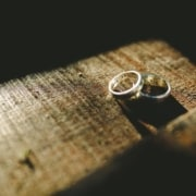 Two rings sit on a table after a couple went through rigorous divorce planning