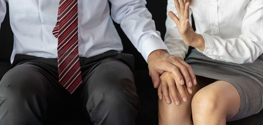A woman seeks help from harassment lawyers after a man disrespects her boundaries.