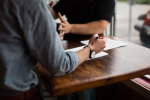 A person meets with a divorce planning lawyer