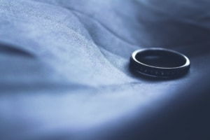 A wedding band sits on fabric after a couple fought over legal separation and divorce.