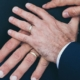 A partner rests their hand on top of their fiance's hand as they discuss a prenup agreement